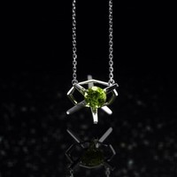 Star  white  gold  and  peridot  pendant  necklace