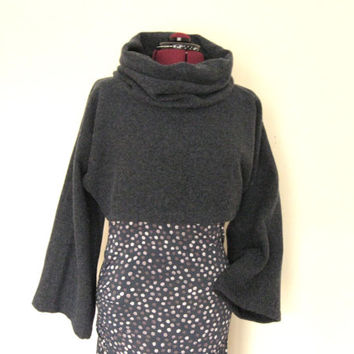 Elegant, short ,blue wool turtleneck , long and wide sleeves, high collar, unusual design, suitable for cold weather.