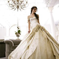 Bridal Snob  Wedding dress w/ subtle floral accents. Love.