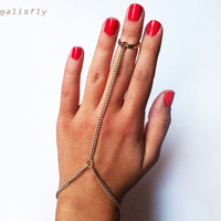 Above the Knuckle Gold Ring with Gold Chain Slave Bracelet hand piece mid finger