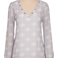 Chiffon tunic with grommets at neckline