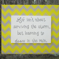 "Hand Painted Wooden Chevron Gray and Yellow Sign, ""Life isn't about surviving the storm...but learning to dance in the rain."""