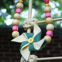 Hadley Pinwheel Necklace, Felt Pinwheel in Blue Spruce and Soft Lemon Yellow with wooden beads in pink, yellow, and purple