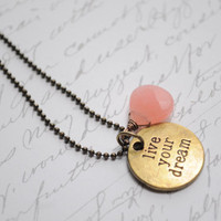 Live your Dream-- Antique bronze and brass charm necklace with strawberry quartz