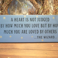 A Heart is not Judged Wizard Of Oz Painted Wood Sign Primitive Blue