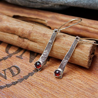14K Gold earrings. Garnet. Rose cut garnets. Long solid yellow gold earrings. hand hammered and textured. shiny. rustic. bezel set.