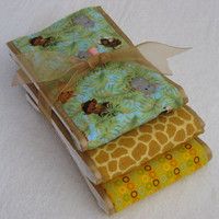 Baby Burp Cloths - baby animal jungle motif fabric coordinated with other flannel fabric and oatmeal colored ribbon, sewn on diaper