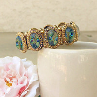 Encased Peacock Bracelet [2633] - $14.00 : Vintage Inspired Clothing & Affordable Summer Dresses, deloom | Modern. Vintage. Crafted.