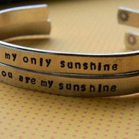 you are my sunshine/my only sunshine  two aluminum bracelets 1/4 inch wide