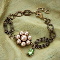 Vintage style pink pearl flower bracelet with antique brass decorative chain and green gem dangle