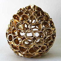 Golden Egg ceramic sculpture
