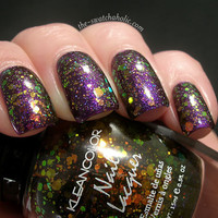 Glittertastic layering of the day Kleancolor - Chunky Holo Black over OPI Servin' Up Sparkle over OPI Grape Set Match | The Swatchaholic . a blog about nail polish and makeup