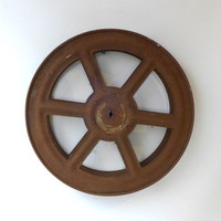 Vintage industrial rusty cinema movie film reel spool
