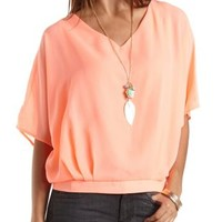 Caged Back Dolman Sleeve Top by Charlotte Russe - Neon Coral
