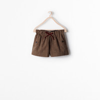 Piped checked shorts