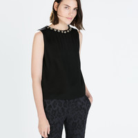 Low-cut top with back zip