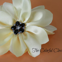 Yellow Handmade Flower with black flower embellishment on the center. Baby headband. Flower on a hair tie. Hair Accessory. Gorgeous headband