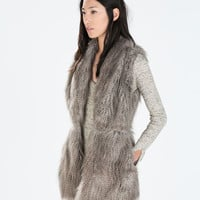 Fur vest with waist seam