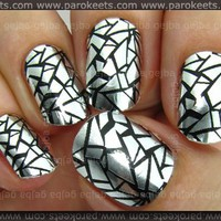 http://www.parokeets.com/wp-content/uploads/2010/09/Essence_Nail_Fashion_Sticker_Unexpected.jpg