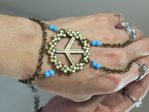 "Bronze Peace Sign ""Slave Bracelet"" Ring. Peace Sign and Flower Charm Accented with Baby Blue beads. Fits Wrists 6 to 8 inches. Adjustable."