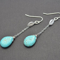 Turquoise teardrop and matte finished leaf silver earrings.
