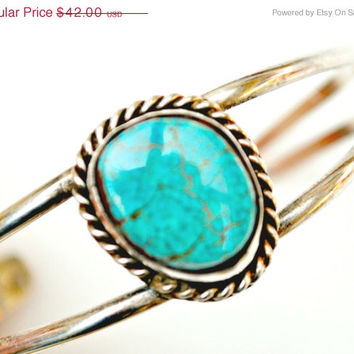 Native American Sterling silver Turquoise small cuff bracelet.