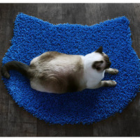 Fluffy electric blue carpet - cat head shape