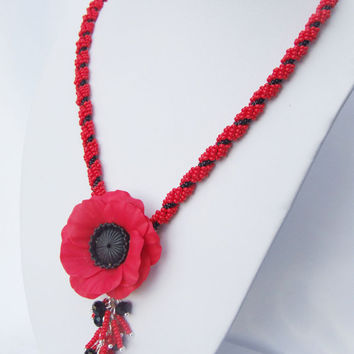FREE SHiPPING. Red and black necklace seed beads  lariant with polimer clay poppy