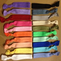 4 Solid Elastic Hair Ties (and Brac.. on Luulla