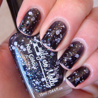 "Nail polish - ""Insomnia"" white, silver holo and iridescent glitter in a black jelly base"