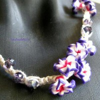 A Bunch of purple flowers necklace by handmadefuzzy on Zibbet