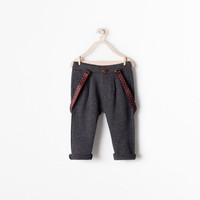 Pleated trousers with braces