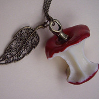 an red apple necklace ,with a leaf