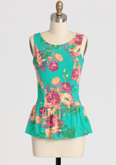 floral compass peplum top at ShopRuche.com