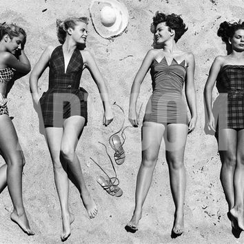 Models Sunbathing, Wearing Latest Beach Fashions Photographic Print by Nina Leen at Art.com
