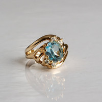 18KT Ring GE Light Blue Stone and Rhinestone Size 7