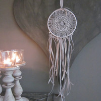 A vintage lace doily dream catcher adorned with some chandelier glass hangers --- A delicate dream catcher for a vintage elegant touch
