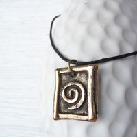 Minimalist zen swirl pendant made of bronze, handmade and unique on sale