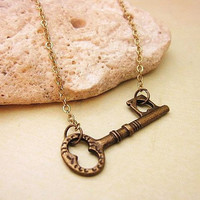 Sideways key necklace in bronze finish