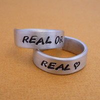 Hunger Games Inspired - Real or Not Real and Real - A Pair of Hand Stamped Adjustable Aluminum Rings