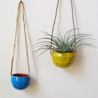 Terracotta hanging planter pot vase with bright yellow by mudpuppy