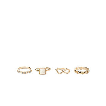 Twisted Infinity Stackable Rings - 4 Pack by Charlotte Russe - Ivory