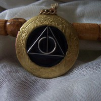 celebration price Deathly hallows symbol locket by 1luckysoul