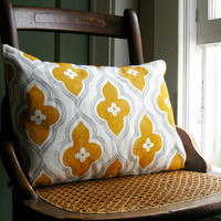gray and yellow ochre ogee on white linen lumbar by giardino