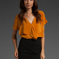 CUT25 Silk Ruffle Front Top in Marigold at Revolve Clothing - Free Shipping!