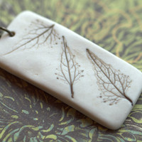 Earthy Porcelain Pendant with Impression of a leaves.
