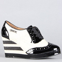 The Anna Sui x Hush Puppies Oxford Wedge in Black Patent and White Canvas