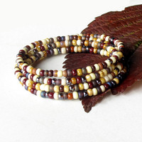 Stacking beaded bracelets - Fall shades of maroon, tan, eggplant & ivory  - 4 bangles in one
