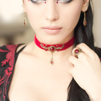 Red velvet choker with bronze details and Swarovski crystals
