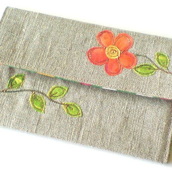 Handmade fabric card holder. Embroidered card holder, orange flower design, natural linen with green spotty fabric lining. Made in England.